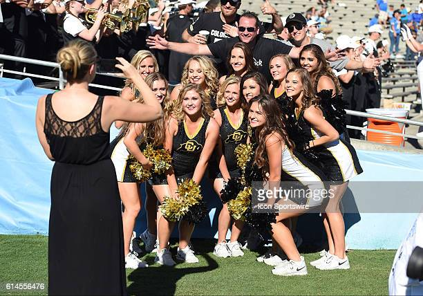 Colorado cheerleaders pose for a photo with a fan during an NCAA football game between the Colorado Buffaloes and the UCLA Bruins at the Rose Bowl in...