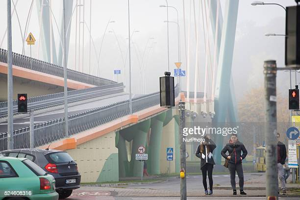 October 2015 - Despite above average temperatures people go out dressed for the cold in Poland. Air pollution increases severely in the cold months...