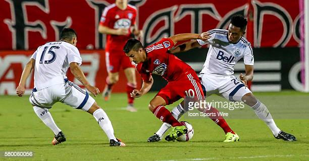 FC Dallas Mauro Diaz tries to get past Whitecaps Deybi Flores and Matias Laba during the MLS game between the Vancouver Whitecaps FC and FC Dallas at...