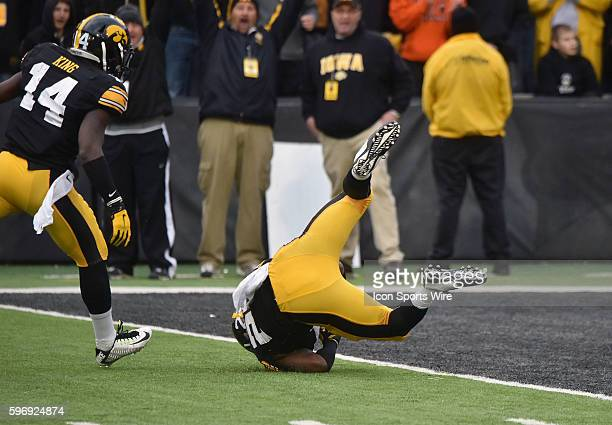 Iowa free safety Jordan Lomax rolls into the endzone after intercepting a pass during a Big Ten football game between the Maryland Terrapins and the...