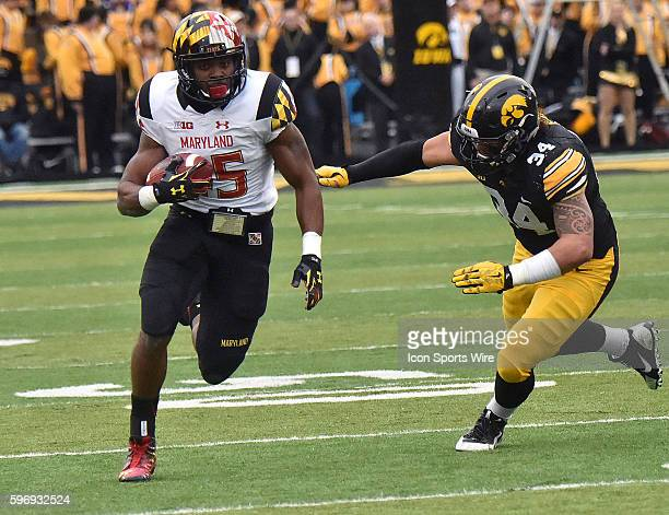Iowa left end Nate Meier tries to tackle Maryland running back Wes Brown during a Big Ten football game between the Maryland Terrapins and the Iowa...