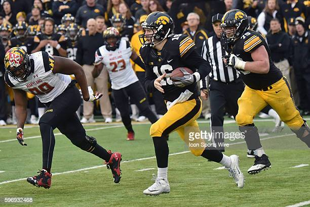 Iowa quarterback C.J. Beathard runs the ball during a Big Ten football game between the Maryland Terrapins and the Iowa Hawkeyes at Kinnick Stadium....