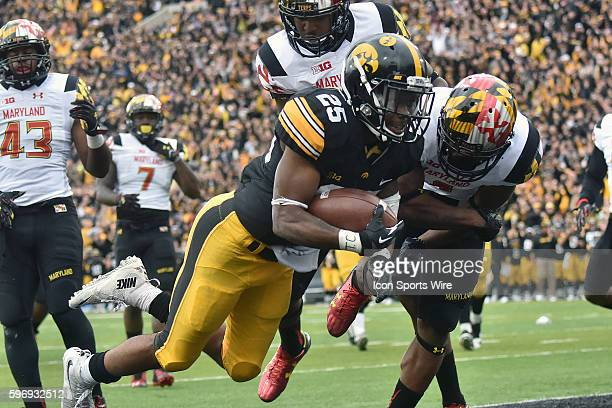 Iowa running back Akrum Wadley scores in the second quarter on a 11-yard run during a Big Ten football game between the Maryland Terrapins and the...
