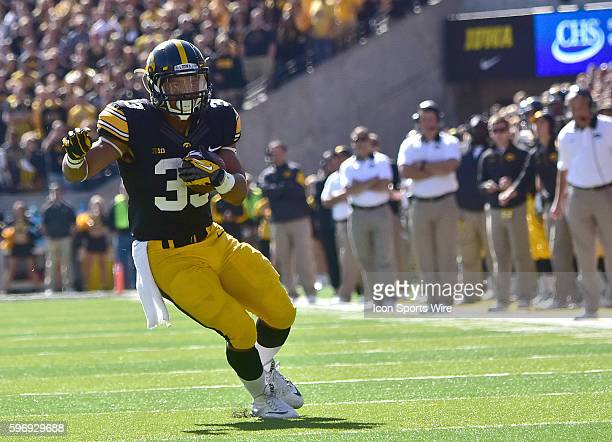 Iowa running back Jordan Canzeri scores on a 17-yard pass play during a Big Ten Conference football game between the University of Iowa Hawkeyes and...
