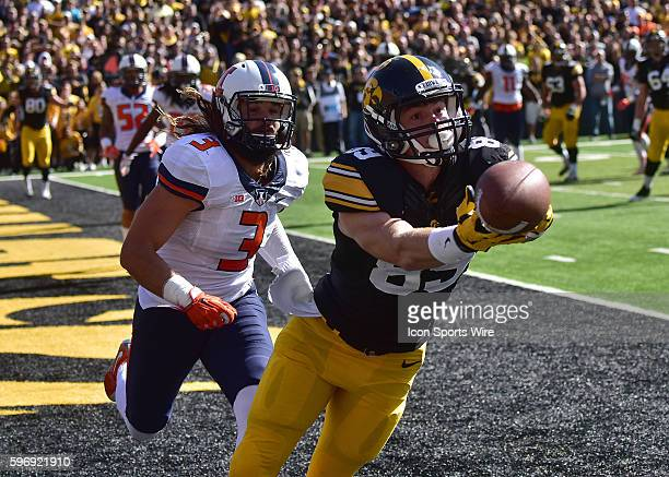 Iowa wide receiver Matt VandeBerg can't hang on to a sideline pass during a Big Ten Conference football game between the University of Iowa Hawkeyes...