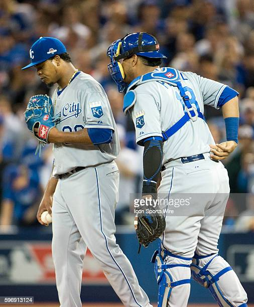 Kansas City Royals opening pitcher Edinson Volquez and catcher Salvador Perez confer at the mound in the sixth inning of game 5 of ALCS against...