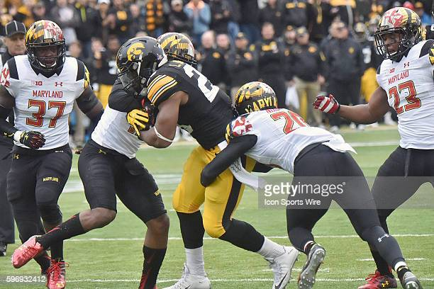 Maryland safety Anthony Nixon tackles Iowa running back Akrum Wadley during a Big Ten football game between the Maryland Terrapins and the Iowa...