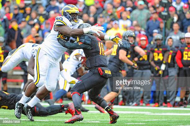 Michigan Wolverines defensive tackle Willie Henry sacks Maryland Terrapins quarterback Daxx Garman at Byrd Stadium in College Park MD where the...