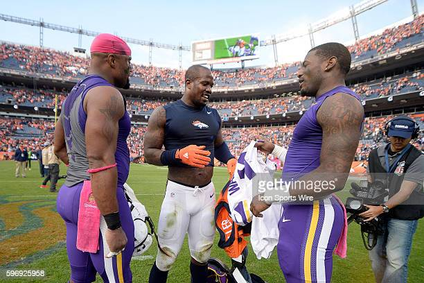 Minnesota Vikings Wide Receiver Mike Wallace [10112] and Denver Broncos Linebacker Von Miller [16558] exchange their jersey's after the game in...