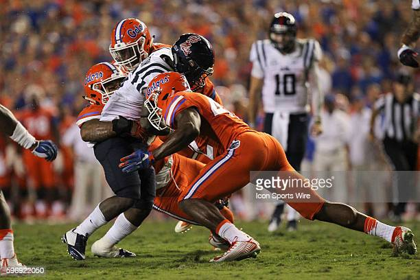 Mississippi Rebels running back Jaylen Walton is tackled by Florida Gators linebacker Antonio Morrison Florida Gators defensive back Keanu Neal and...