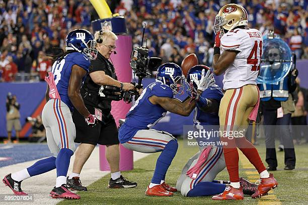 New York Giants Tight End Larry Donnell [15613] celebrates with New York Giants Wide Receiver Odell Beckham [11114] and teammates after catching a...