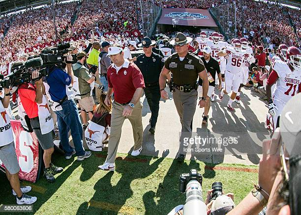 Oklahoma Sooners players exit the tunnel before the Oklahoma Sooners versus the Texas Longhorns in the Red River Rivalry at the Cotton Bowl in...
