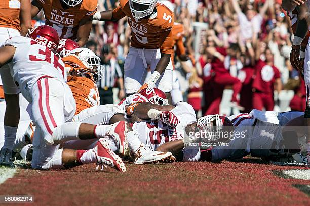 Oklahoma Sooners players score a touchdown during the fourth quarter during the Oklahoma Sooners versus the Texas Longhorns in the Red River Rivalry...