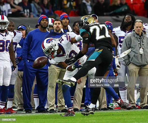 Robert Wood fails to hold a pass under pressure from Aaron Colvin during the International Series Game 13 between the Buffalo Bills and the...