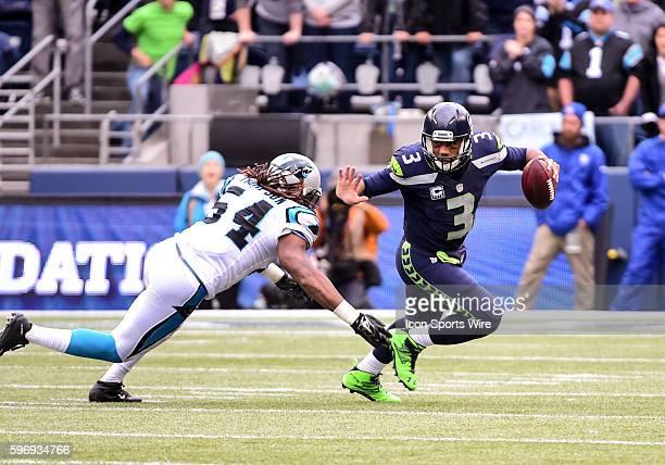 Seattle Seahawks quarterback Russell Wilson scrambles from Carolina Panthers outside linebacker Shaq GreenThompson as the Carolina Panthers defeat...