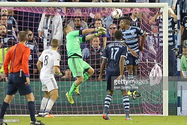 Sporting KC goalkeeper Tim Melia makes a critical save in extra time to preserve the victory in the MLS regular season finale between the LA Galaxy...