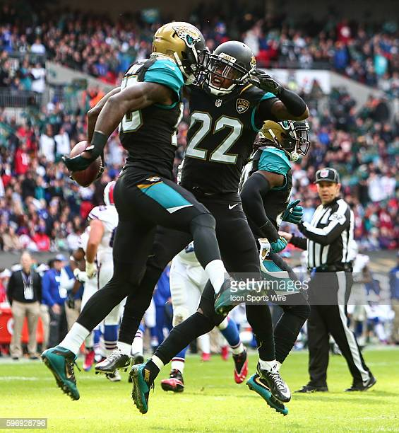 Telvin Smith and Aaron Colvin celebrate a touchdown during the International Series Game 13 between the Buffalo Bills and the Jacksonville Jaguars...
