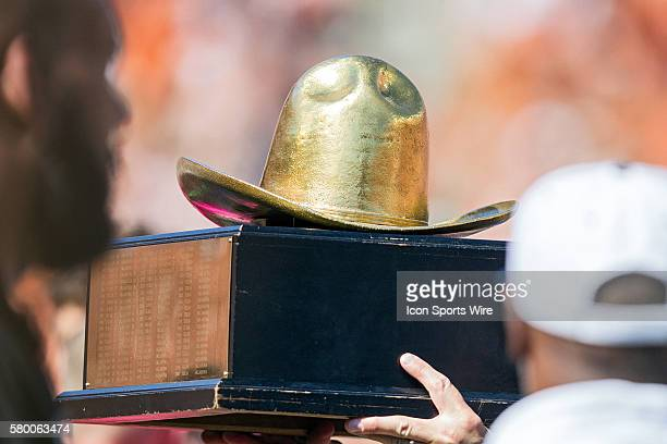 Texas Longhorns players are presented the trophy after winning the Red River Showdown after the Texas Longhorns victory over the Oklahoma Sooners in...