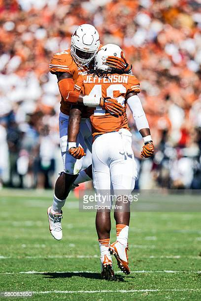 Texas Longhorns players celebrate during the Oklahoma Sooners versus the Texas Longhorns in the Red River Rivalry at the Cotton Bowl in Dallas, TX.