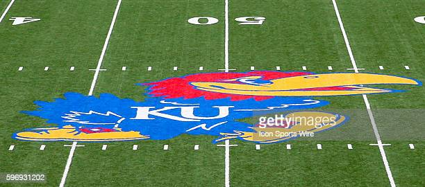 The Kansas Jayhawks logo on the 50 yard line at Memorial Stadium on the campus of Kansas University in Lawrence KS