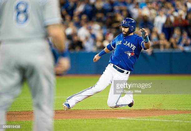 Toronto Blue Jays right fielder Jose Bautista slides in to second base in the fourth inning of game 5 of ALCS against Kansas City Royals at Rogers...