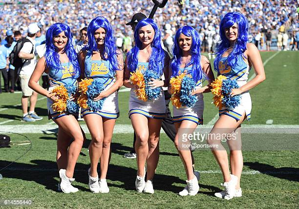 UCLA cheerleaders dressed up for Halloween in blue wigs during an NCAA football game between the Colorado Buffaloes and the UCLA Bruins at the Rose...