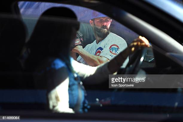 A car passes by a banner of Jake Arrieta outside of Wrigley Field prior to the NLCS with the Chicago Cubs against the Washington Nationals or the Los...