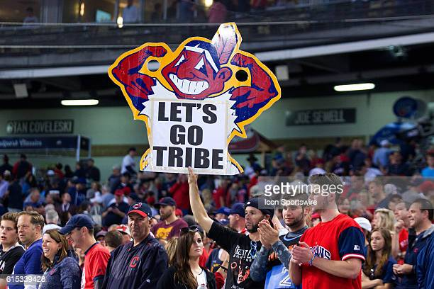 A Cleveland Indians fan holds up a sign as the celebration ensues following the American League Championship Series Game 2 between the Toronto Blue...