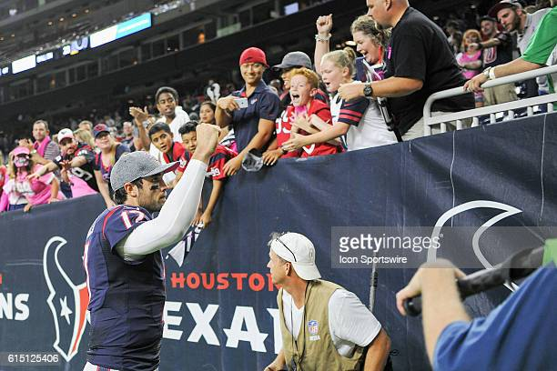 Young fan reactsto catching Houston Texans Quarterback Brock Osweiler's towel following the NFL game between the Indianapolis Colts and Houston...