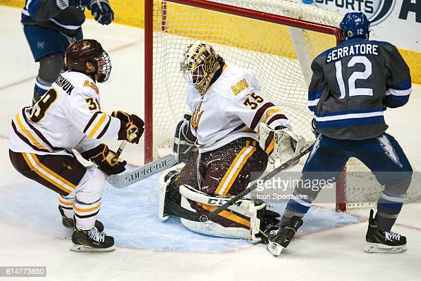 Air Force Falcons forward Matt Serratore scores a goal on Arizona State Sun Devils goalie Joey Daccord during the NCAA hockey game between the...