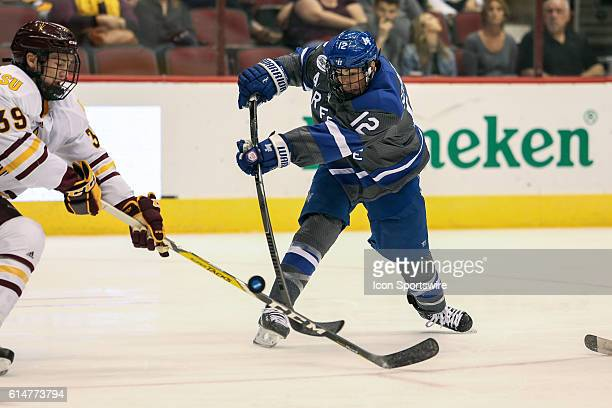 Air Force Falcons forward Matt Serratore takes a shot during the NCAA hockey game between the Arizona State Sun Devils and the Air Force Falcons at...