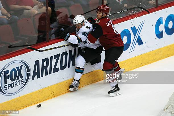 Arizona Coyotes defenseman Jakob Chychrun checks San Jose Sharks forward Matt Nieto during the preseason NHL hockey game between the San Jose Sharks...