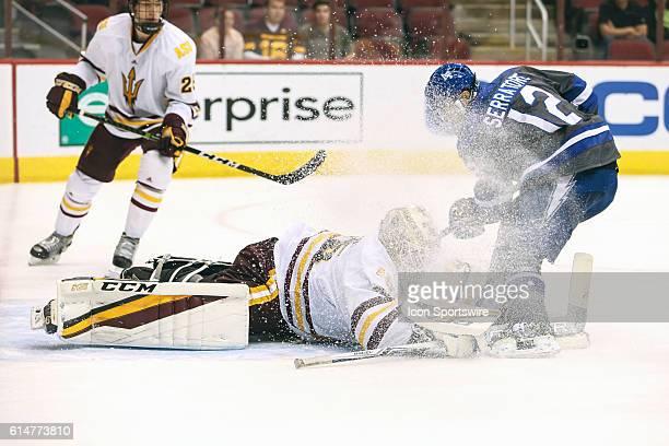 Arizona State Sun Devils goalie Joey Daccord makes a save vs Air Force Falcons forward Matt Serratore during the NCAA hockey game between the Arizona...