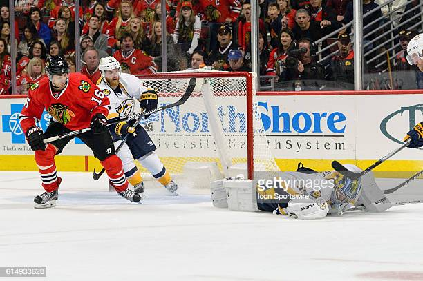 Chicago Blackhawks Center Marcus Kruger watches as Nashville Predators Goalie Marek Mazanec falls on a puck in the 3rd period during a game between...