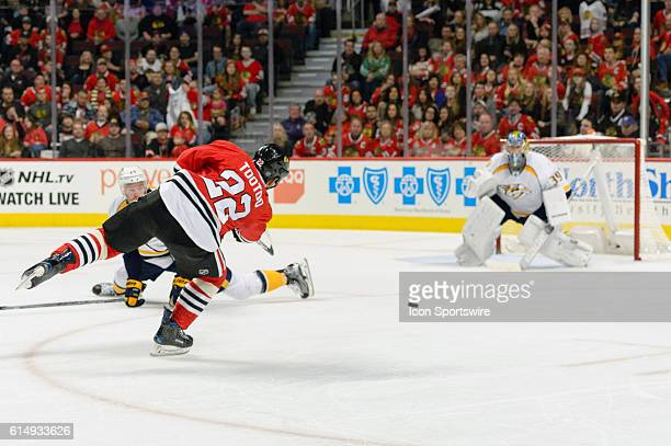 Chicago Blackhawks Right Wing Jordin Tootoo shoots on Nashville Predators Goalie Marek Mazanec in the 3rd period during a game between the Nashville...