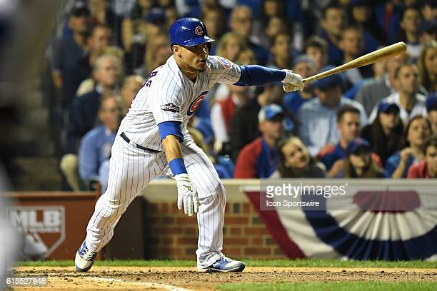 Chicago Cubs catcher Willson Contreras hits a single during the fifth inning in game two of the National League Championship Series between the Los...
