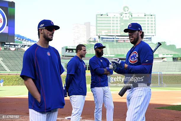 Chicago Cubs first baseman Anthony Rizzo and Chicago Cubs right fielder Jason Heyward and Chicago Cubs third baseman Kris Bryant and Chicago Cubs...