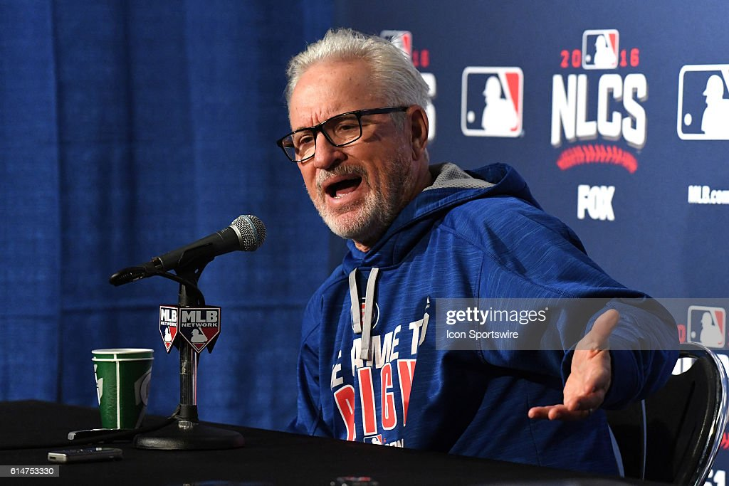 Chicago Cubs manager Joe Maddon (70) answers questions from the media prior to the Chicago Cubs workout at Wrigley Field prior to the NLCS against the Los Angeles Dodgers in Chicago, IL.