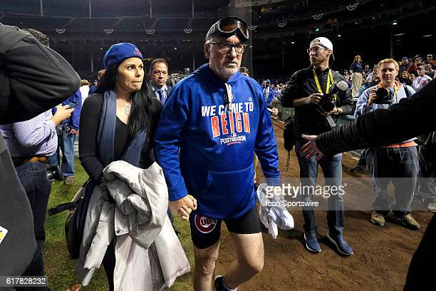 Chicago Cubs manager Joe Maddon gives an interview with his wife Jaye Sousoures Maddon celebrate winning the NLCS after defeating the Los Angeles...