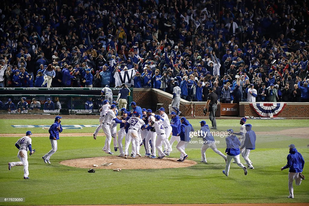 Chicago Cubs players and staff celebrate winning the NLCS after defeating the Los Angeles Dodgers in action during the 9th inning of game six of the National League Championship Series between the Los Angeles Dodgers and the Chicago Cubs at Wrigley Field in Chicago, IL.