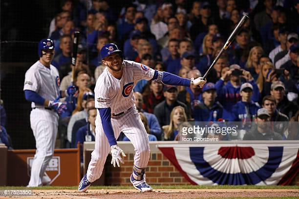 Chicago Cubs third baseman Kris Bryant hits the ball in action during the 1st inning of game six of the National League Championship Series between...