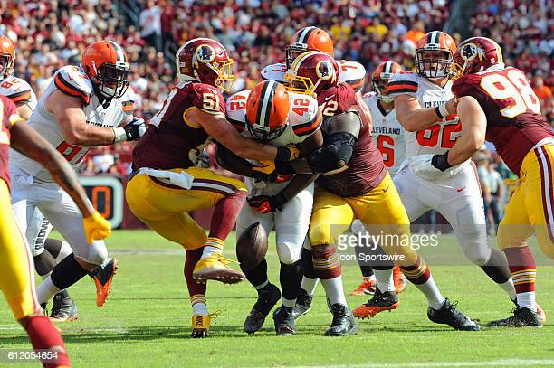 Cleveland Browns fullback Malcolm Johnson fumbles the ball on a tackle by Washington Redskins inside linebacker Will Compton and defensive end Chris...