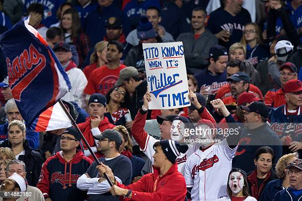 6b68f395bbc Cleveland Indians fans hold up a sign as Cleveland Indians Pitcher Andrew  Miller enters the game