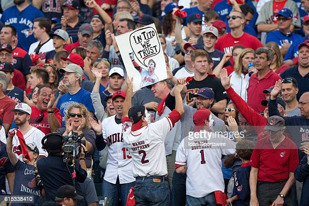 99ddfafb01e Cleveland Indians fans hold up a sign during the seventh inning of the American  League Championship