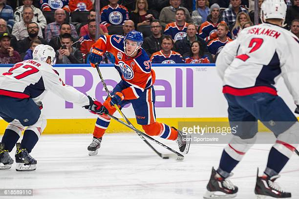 Connor McDavid the Edmonton Oilers skates to the middle and shoots the puck during the Washington Capitals game versus the Edmonton Oilers at Rogers...