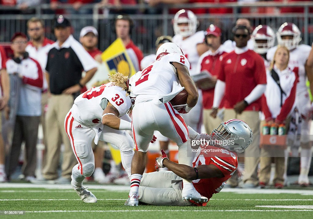 Cornerback Joshua Norwood (28) of the Ohio State Buckeyes makes a tackle on running back Devonte Williams (2) of the Indiana Hoosiers during the game between the Indiana Hoosiers and the Ohio State Buckeyes at Ohio Stadium in Columbus, Ohio.