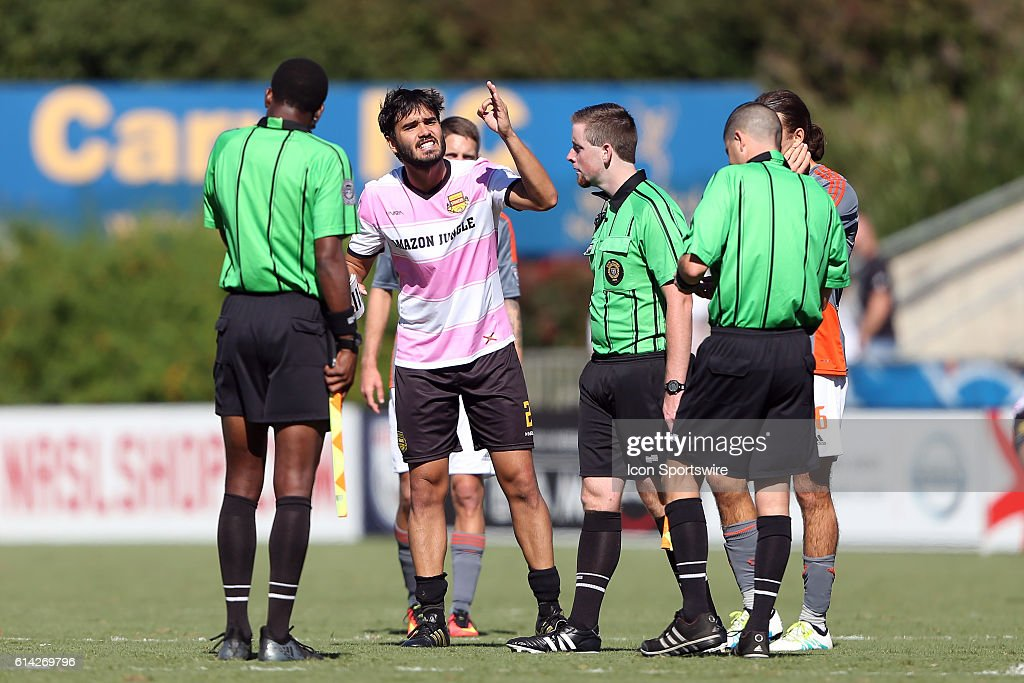 Fort Lauderdale's Dalton (BRA) (2) confronts referee Younes Marrakchi (right) after the game. The Carolina RailHawks hosted the Fort Lauderdale Strikers at WakeMed Soccer Park in Cary, North Carolina in a 2016 North American Soccer League Fall Season match. Carolina won the game 3-0.