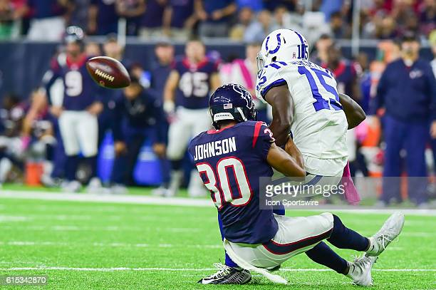 Houston Texans Cornerback Kevin Johnson breaks up a pass intended for Indianapolis Colts Wide Receiver Phillip Dorsett during the NFL game between...