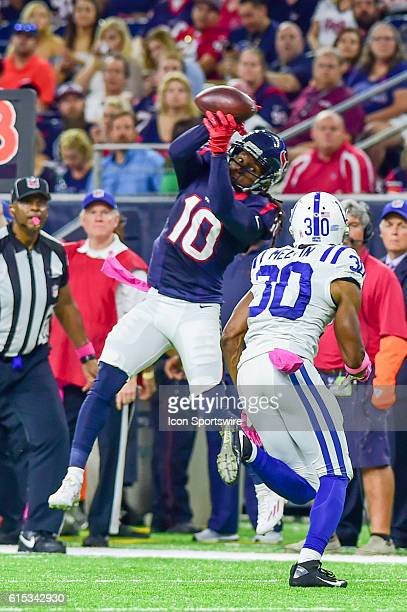 Houston Texans Wide Receiver DeAndre Hopkins makes a catch as Indianapolis Colts Cornerback Rashaan Melvin defends during the NFL game between the...
