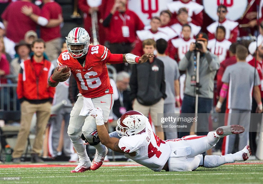 Linebacker Marcus Oliver (44) of the Indiana Hoosiers attempts to tackle quarterback J.T. Barrett (16) of the Ohio State Buckeyes during the game between the Indiana Hoosiers and the Ohio State Buckeyes at Ohio Stadium in Columbus, Ohio.